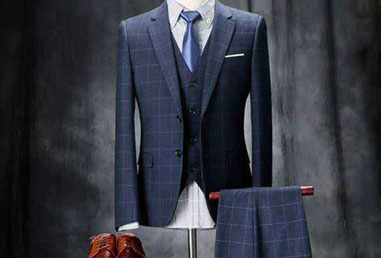 Ironing and shaping of suits and trousers